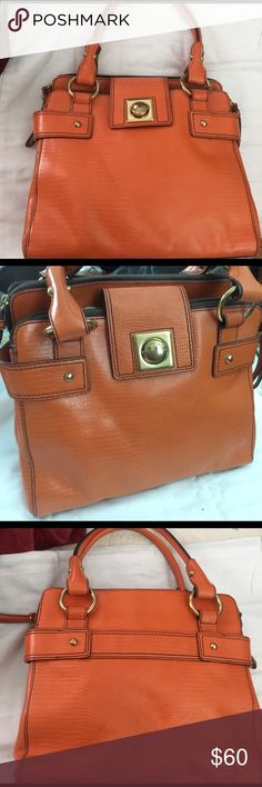 A must have for Spring. Fashionable and Roomy Embossed Leather satchel with brass hardware. Two zippered compartments and on large open compartment. Brown satin BR lining in perfect condition. Excellent condition. Banana Republic Bags Satchels