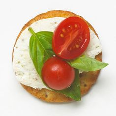Herbed cheese spread, fresh basil, cherry tomatoes./