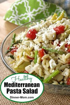 This Healthy Mediterranean Pasta Salad is packed with artichoke hearts tomatoes asparagus scallops (or shrimp) and topped with feta cheese! A family favorite! Artichoke Heart Recipes, Artichoke Hearts, Wheat Pasta Recipes, Cold Pasta Recipes, Seafood Recipes, Dinner Recipes, Appetizer Recipes, Mediterranean Pasta Salads, Best Pasta Dishes