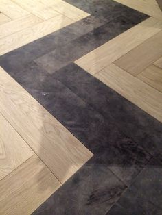 Oversize heeringbone Leather Floor combined With wood