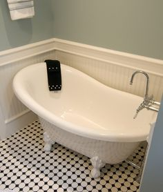 Claw foot tub, great wall color and tile...