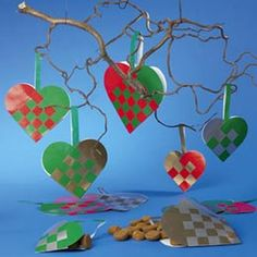 Love these Danish woven hearts!  I've crafted many in assorted color combos for my Danish Christmas tree.  Tradition calls for red & white in remembrance of the Danish flag.