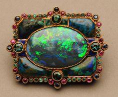 Brooch | Marie Zimmermann. Gold, black opal, shattuckite, green tourmalines, emeralds, sapphires, rubies, and enamel. ca. 1920 - 1928