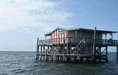 Stilt house in the Gulf of Mexico off Port Richey, FL.     (House = YES! Flag = Unnecessary!)