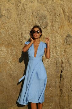 Women's fashion | Deep cleavage on pastel blue dress