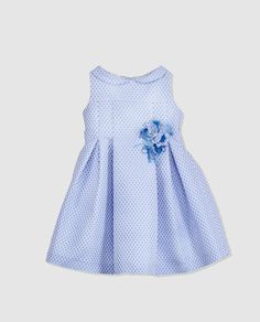Vestido de niña Torres en azul con flor.