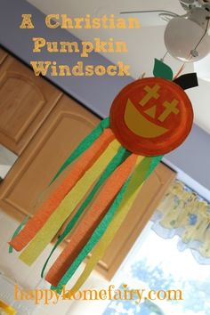 Christian Pumpkin Windsock Craft at happyhomefairy.com with adorable FREE Printable poem!