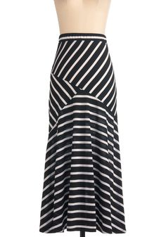 striped skirt! The way the stripes are will flatter your shape and help you appear skinnier!