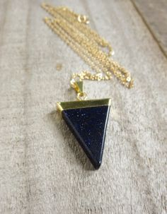 An amazing midnight blue goldstone point glides freely along a sparkling 14K gold fill cable chain to create this edgy, everyday necklace.