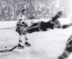 Boston Bruins' Bobby Orr goes into the air after being tripped right after scoring the overtime goal against the St. Louis Blues that won the Stanley Cup for the Bruins in Boston. May 10 1970 x Boston Bruins Hockey, Hockey Mom, Hockey Teams, Hockey Players, Hockey Stuff, Pro Hockey, Rangers Hockey, Hockey Girls, Volleyball Players