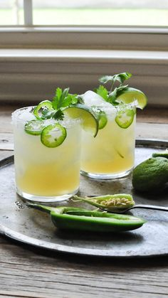 Fresh Lime and Jalapeno Margarita by fedandfiddt This fresh lime & jalapeno margarita is simply made with lime juice, silver tequila, honey, and some jalapeno + cilantro for a delicious Paleo twist. Jalapeno Margarita, Margarita Recipes, Spicy Margarita Recipe, Cocktails Champagne, Cocktail Drinks, Cocktail Recipes, Margarita Cocktail, Cocktail Ideas, Summer Drinks