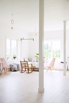 bright white living room with modern wood chairs / sfgirlbybay