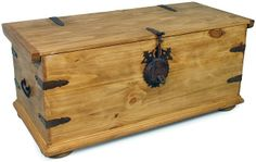 """This rustic trunk makes a great coffee table and the ideal storage solution for your living room or family room. Beautifully handcrafted from solid kiln-dried pine and accented with rustic iron hinges and a locking latch. Measures: 39"""" w x 17"""" d x 17"""" h"""