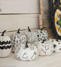 I love this fun black white and yellow Halloween Mantel with all kinds of DIY Halloween Decor projects at thehappyhousie.com-18