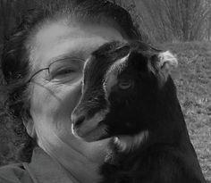 Grandma Donna holding Bella. love the goat