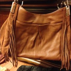 B Makowsky handbag B Makowsky leather and suede NWOT handbag comes with dust covers large front pocket cell phone pocket on back snap closure with zipper pocket inside 3 pockets inside also can be worn on shoulder or arm  really nice bag B Makowsky Bags Hobos