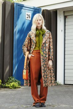 Coat, Price Upon Request, Turtleneck, $495, Calvin Klein Collection; Bag, Price Upon Request, Salvatore Ferragamo.   - MarieClaire.com