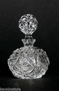 Lovely crystal perfume bottle ~ Tiffany Co Rock Cut Crystal Perfume Bottle w Stopper Fine Crystal Crystal Perfume Bottles, Antique Perfume Bottles, Vintage Bottles, Bottle Vase, Glass Bottles, Perfumes Vintage, Beautiful Perfume, Glass Art, Cut Glass