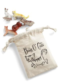 This drawstring-close pouch holds a set of 6 petite, plastic kitty figurines, all in different breeds and poses.