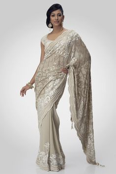 A drape embellished lush sequines and ornamented with beads and an crystallized blouse adds elegance to a beautiful day.