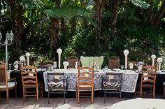 I don't want a baby shower outside, but the mismatched chairs and decor is super cute. #aliceinwonderland