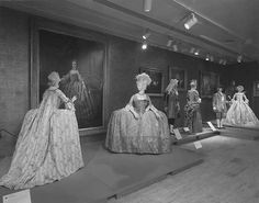 Old photograph of a costume exhibit from The Metropolitan Museum of Art, showing c. 1750 court dress (accession number: C.I.65.13.1a–c) in the middle