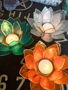 """Stunning lotus votive tea light holders made with real capiz shell. Add a luminous and delicate touch to your home. 5 1/2"""" x 2.5"""""""