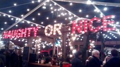 From the Kensington Christmas market. Strings of lights; lit signs