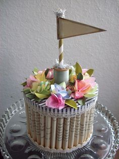 Paper Bakers New Recipe......  Pages of a vintage paperback book are rolled into a sweet and petite paper cake. Frosted with patterned paper and