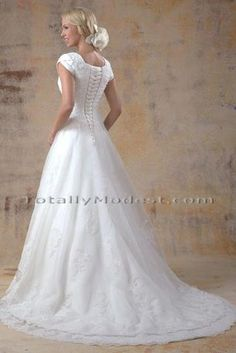 Modest wedding dress with lace and corset back