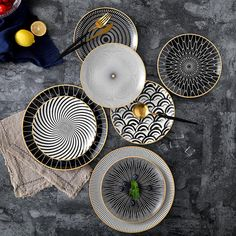These dinner plates are amazingly beautiful and durable. They have phnom penh geometry design and are made of ceramics. You can use them as dessert plates, cake plates etc. We have them avaliable in different patterns, colours and in 8 and 10 inch sizes. Dinner Plate Sets, Dinner Plates, Dinner Ware, Dinner Sets, Vase Deco, Ceramic Tableware, Ceramic Materials, Plate Design, Dish Sets