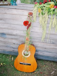 Flower adorned Spanish guitar ⎪We Are Origami Photography ⎪see more on: http://burnettsboards.com/2015/07/spanish-fiesta-wedding-ideas/