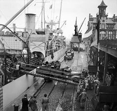 Oil being unloaded from the SS Fort Cataraqui in the Belgian port of Antwerp, 30 november  1944. This was the first ship to berth at the port following the opening of the Scheldt Estuary Source Imperial War Museum.