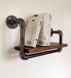 Reclaimed Wood & Pipe Book Shelf - Small by Reclaimed PA on Scoutmob Shoppe. This little wall-mounted bookshelf is made with reclaimed wood and black steel pipe for a modern industrial look.