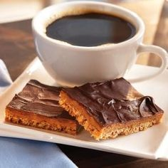 """Coffee Toffee Bars from Folgers® -- These are awesome. I like a little more of the """"toffee filling"""" , so I double that part (increase cook time by mins depending on how gooey you like). I also use either Toasted pecans or hazelnuts for the crust. Great Desserts, Delicious Desserts, Dessert Recipes, Yummy Food, Candy Recipes, Brownie Recipes, Dessert Ideas, Coffee Dessert, Dessert Bars"""