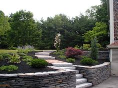 Granite natural stone wall-creating garden design - All About Patio Stairs, Patio Wall, Backyard Patio, Backyard Landscaping, Back Gardens, Outdoor Gardens, Stone Flower Beds, Terraced Landscaping, Garden Retaining Wall
