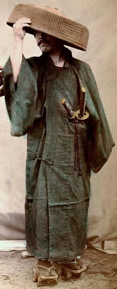 Samurai in wet weather gear, wearing the two swords of the Samurai: Katana and…                                                                                                                                                                                 More