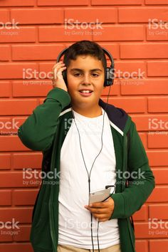 Boy Is Listening Music With Smartphone stock photo 108717375 - iStock