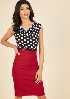 Friend in need of fresh fashion advice? Your expert opinion shines when you're clad in this dotted twofer dress. Featuring a draped black bodice, a form-fitting teal skirt, and a back keyhole accented by a black satin bow, this eye-catching dress will clothe you in confidence.