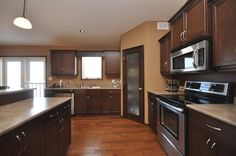 : Wonderful Modern Corner Walk In Pantry Wooden Style Interior And Laminate Flooring