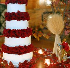 An impeccable Wedding cake accented with stunning red roses