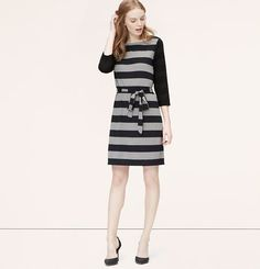 """Two types of stripes inspire this jersey knit design with put-together polish. Boatneck. 3/4 sleeves. Exposed zip at back neck. 20"""" from natural waist."""
