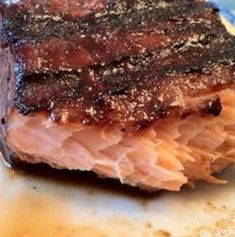 Best salmon marinade! 1/3 c. honey, 1/3 c. soy sauce, 5 cloves garlic and 1 tsp. minced ginger. marinate in refrigerator for 30 min. then wrap it in foil and bake at 425° for approx. 20 minutes. Moist and delicious.