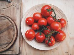 High Angle View Of Cherry Tomatoes In Plate On Table