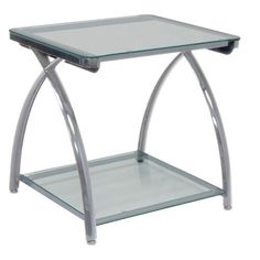 Calico Designs Futura Rectangular Silver Metal and Glass End Table Color - Silver by Calico Designs. $133.99. Protective powder-coat finish on legs. Lower storage shelf. Curved steel legs in silver finish. Coffee table with sleek, simple design. Clear tempered safety glass surfaces. The future is fashionable with the Calico Designs Futura Rectangular Silver Metal and Glass End Table. Built with durability in mind, it features a silver protective powder coat fini...