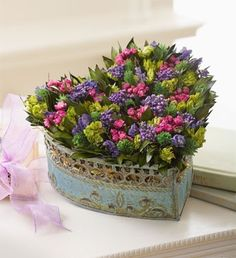 Colorful flowers in heart-shaped tin. Rustically romantic.