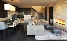 Beck Residence - family room - modern - family room - los angeles - Horst Architects - flooring brushed limestone, white travertine fireplace