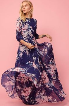 This dress is so pretty! Woodstock Maxi - A romantic floral print complements the elegant, bohemian feel of our Woodstock Maxi. Details include a full-length skirt, 3/4 blouson sleeves, and hidden back zip. We recommend going up a size. This is a promoted post.