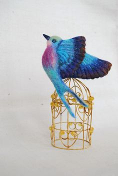 Hey, I found this really awesome Etsy listing at https://www.etsy.com/listing/200474666/needle-felt-brooch-colorful-bird-jewelry