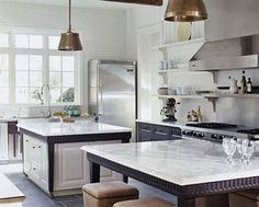 Classic White Marble Countertops              A duo of white marble-topped islands provides ample workspace in this state-of-the-art kitchen. The marble countertops form a classic counterpoint to the professional-style appliances and slate tile floors